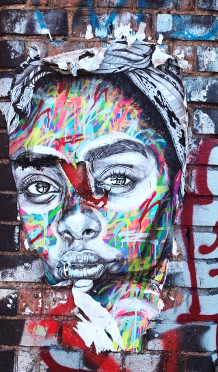 Description: graffiti of woman's face on wall